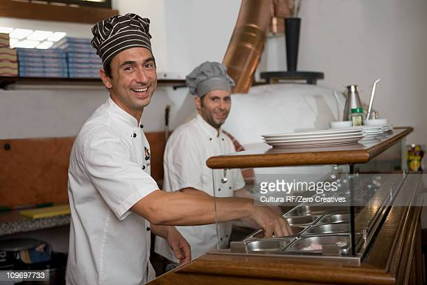people in a pizzaria - pizzeria stock photos and pictures