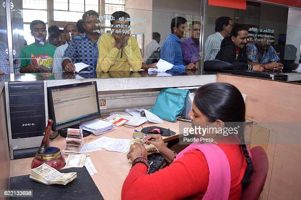 People in a queue at post office to exchange their 500 and 1000 currency in Allahabad.