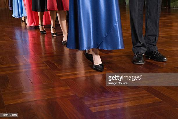 people in a row - evening gown stock photos and pictures