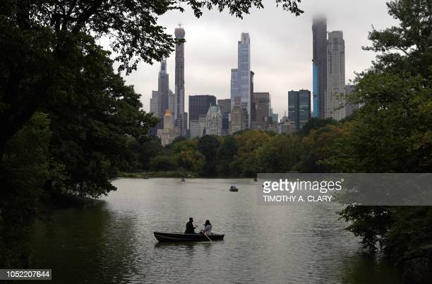 People in a rowboat take advantage of the fall views as they boat around the Central Park Lake October 15 the secondlargest body of water in Central...