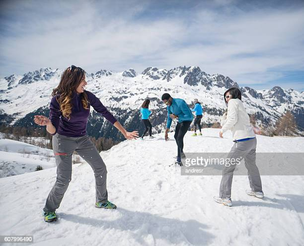 People in a snow fight