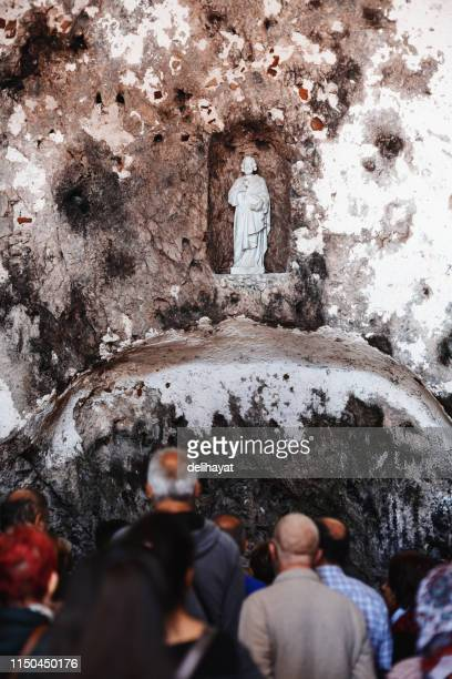 People in an ancient cave church near Antakya (Antioch), Turkey