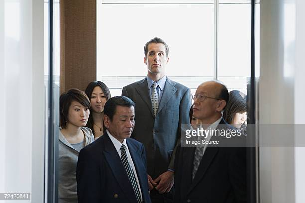 people in an elevator - tall high stock photos and pictures