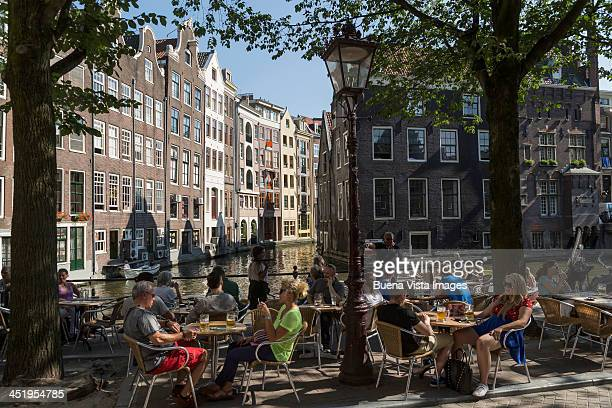 People in an outside cafe in Amsterdam