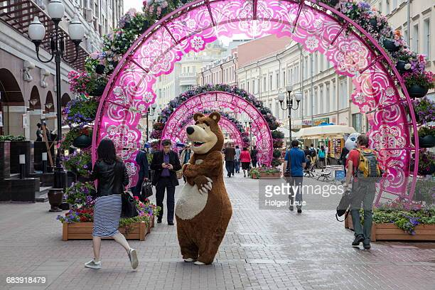people in animal costumes at arbat street - bear suit stock pictures, royalty-free photos & images