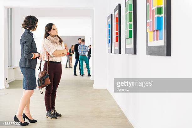 people in art gallery looking at artwork - konstmuseum bildbanksfoton och bilder