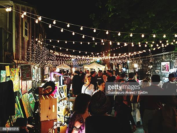 People In Art Market At Night