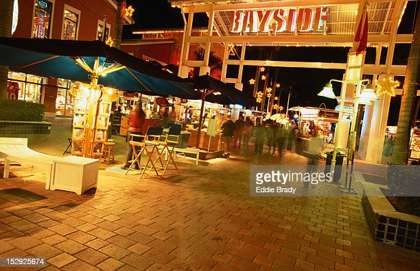 People in Bayside Marketplace at night.