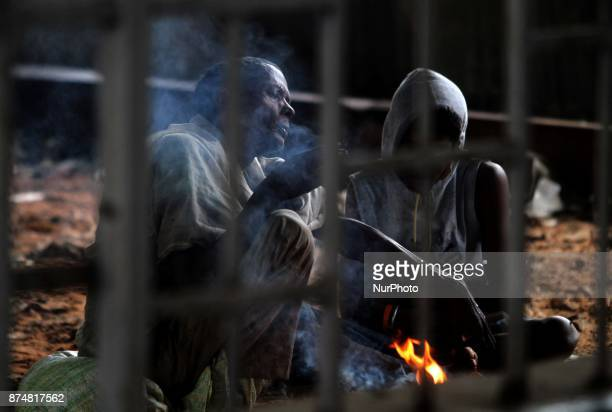 People in Bhubaneswar India on 16 November 2017 as they keeps them near bonfire for warm to protect from low pressure rain Low pressure rain lashes...