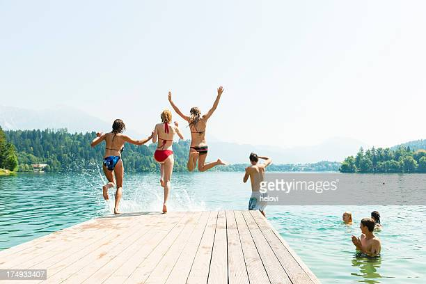 People in bikini jumping in water