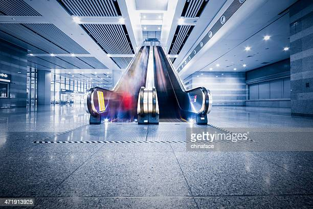 People in blurred motion at airport