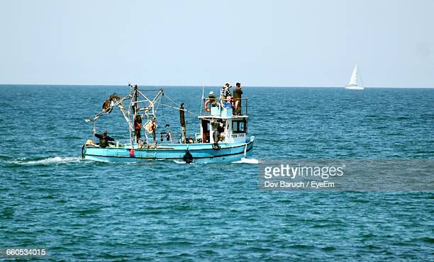 people in boat on sea against clear sky - barulho stock pictures, royalty-free photos & images