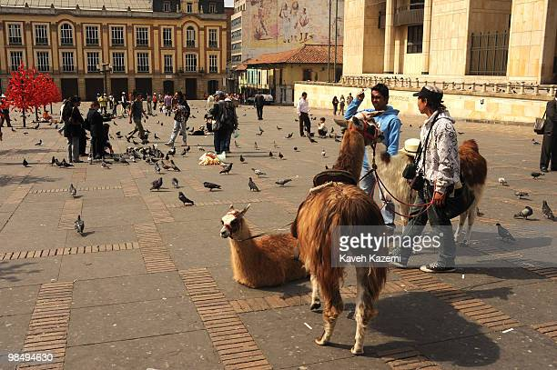 People in Bolivar square prior to Christmas in the old part of the city Bogota formerly called Santa Fe de Bogota is the capital city of Colombia as...