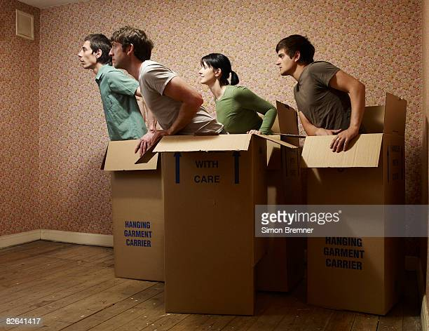 People in boxes facing same direction