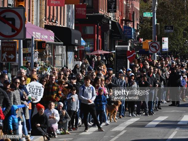 People in Brooklyn watch the 2019 TCS New York City Marathon on November 3 2019 in New York Geoffrey Kamworor and Joyciline Jepkosgei sealed a double...