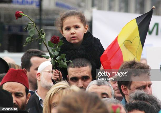 People in Brussels, including Muslims, join a march seeking peace on March 22 the first anniversary of deadly simultaneous terror attacks in Belgium....