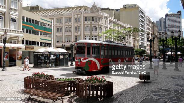 people in bus by city against sky - curitiba stock pictures, royalty-free photos & images