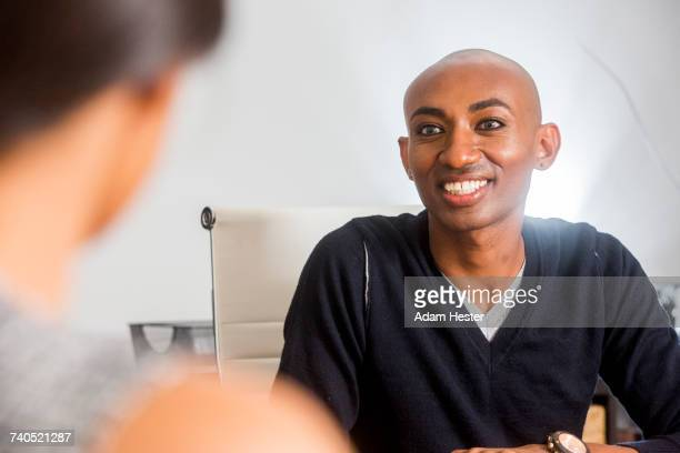people in business meeting - transgender man stock photos and pictures