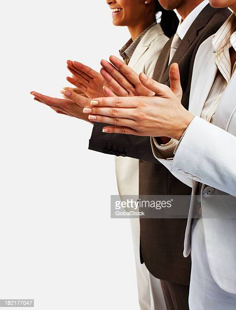 People in business suits clapping