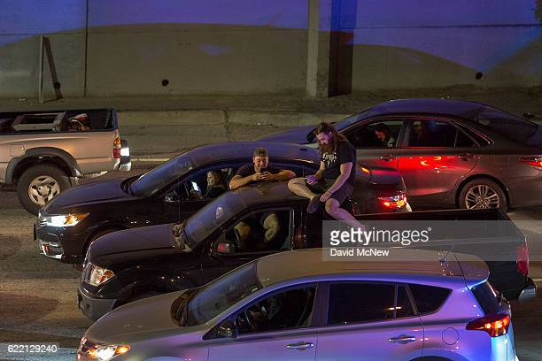 People in cars wait as protesters shut down the 101 freeway below in opposition to the upset election of Republican Donald Trump over Democrat...
