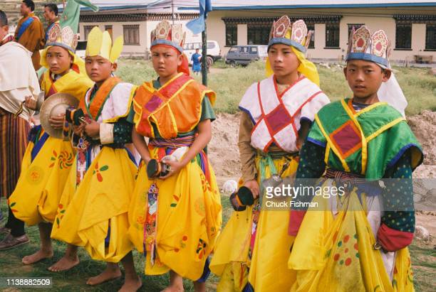 People in ceremonial attire awaiting Trulku Jigme Chode for his stop at the Khuruthang Lhakhang Punakha Bhutan 2004