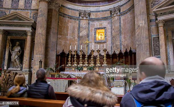 people in church inside of pantheon in rome, italy. - pantheon rome stock photos and pictures