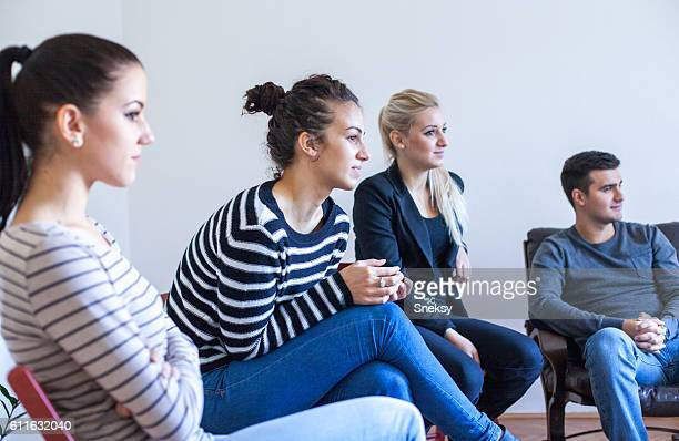 people in circle enjoying group therapy session - community center stock pictures, royalty-free photos & images