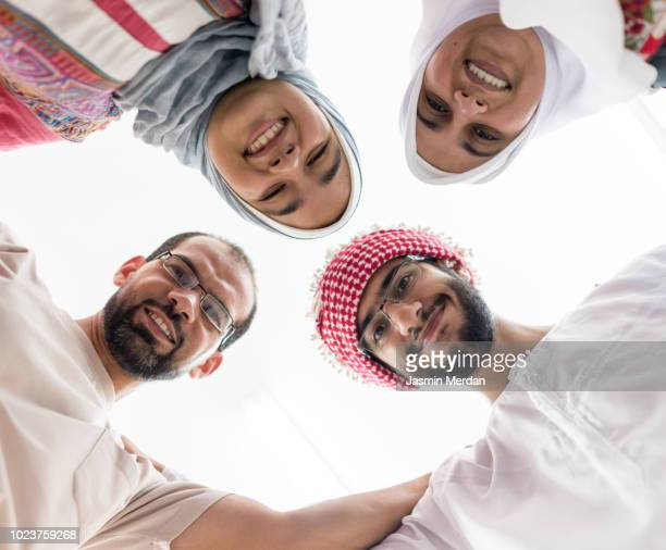 people in circle - muslim boy stock photos and pictures