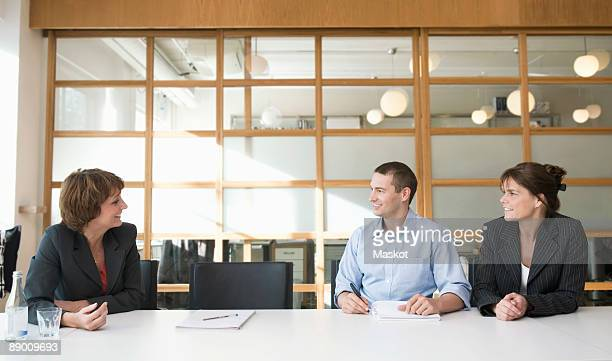 people in conference room - chairperson stock pictures, royalty-free photos & images