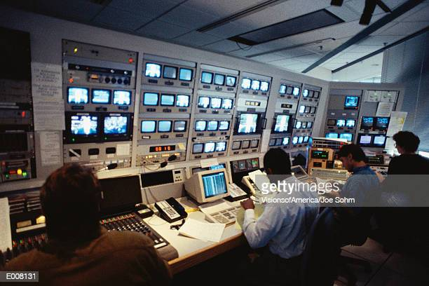 people in control room. - press conference stock pictures, royalty-free photos & images