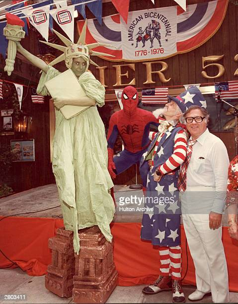 People in costume as the Statue of Liberty, Uncle Sam and Spiderman pose together during the American Bicentennial celebrations, July 1976.