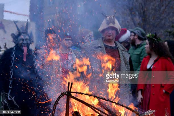 People in costume gather around a bonfire during the eight annual Parade of Spirits Krampus Parade through the Northern Liberties neighborhood of...