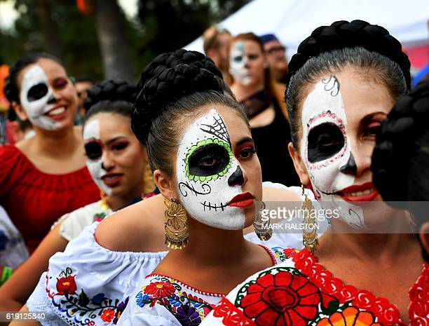 People in costume parade during the annual Dia de los Muertos festival at the Hollywood Forever cemetery in Hollywood California on October 29 2016...