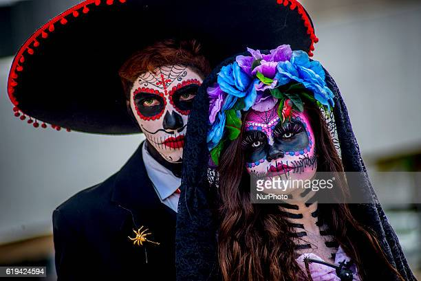 People in costume wait to parade during the annual Dia de los Muertos festival at the Memorial da America latina in São Paulo Brazil on October 30...