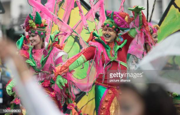 People in costumes participate in the 22nd Carnival of Cultures despite rainy weather in Berlin Germany 4 June 2017 According to the organisers000...