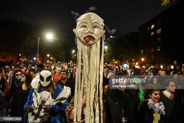 People in costumes participate in the annual Village Halloween parade on Sixth Avenue on October 31 2018 in New York City