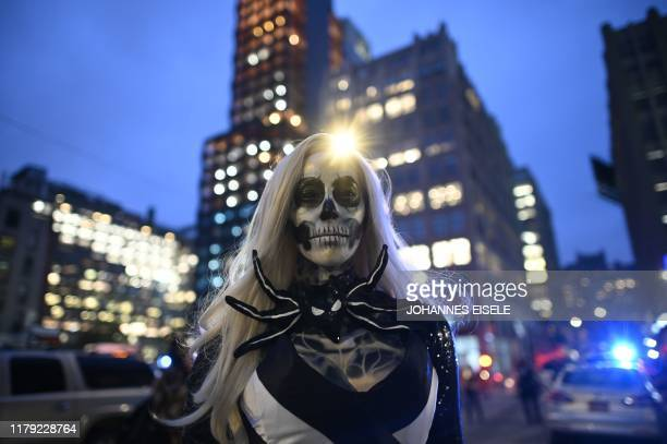 People in costumes participate in the annual Village Halloween parade on Sixth Avenue on October 31 2019 in New York