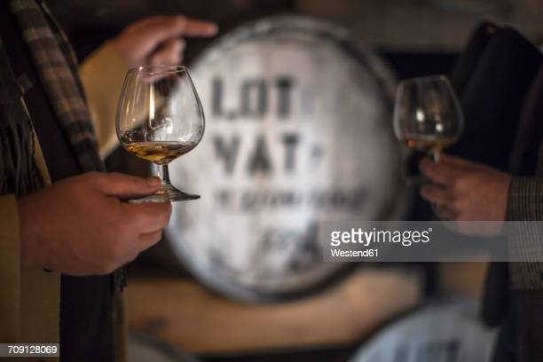 people in distillery tasing whiskey - distillery stock pictures, royalty-free photos & images