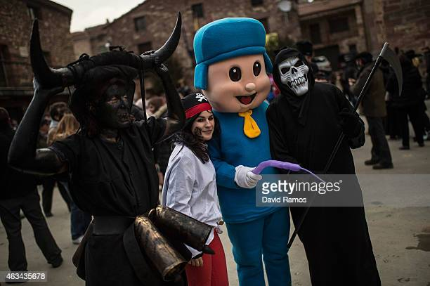 People in fancy dress enjoy the atmosphere during a carnival festival on February 14 2015 in Luzon Spain Every year Luzon hosts one of the leastknown...