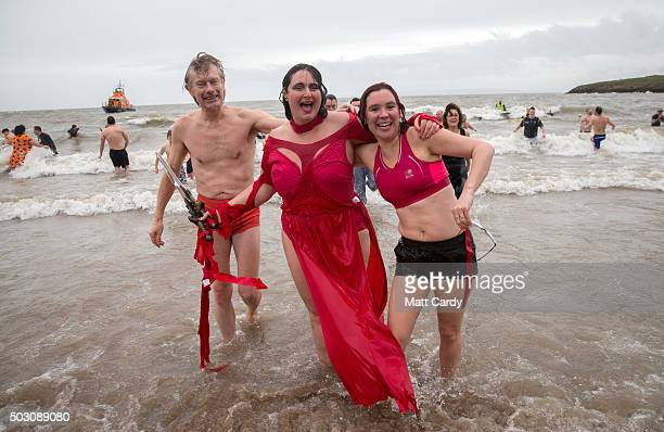 People in fancy dress pose in the sea as they take part in the annual New Year's Day swim at Barry Island as several hundred swimmers marked start of...