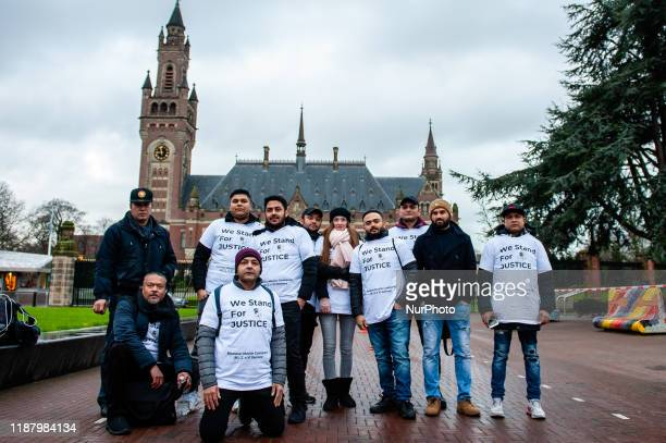 People in favor of Rohingya are posing in front of the ICJ, during the audience of Aung San Suu Kyi, in The Hague, on December 11th, 2019.
