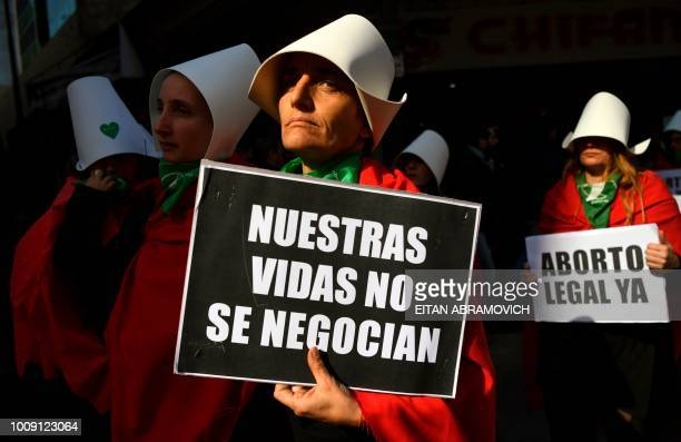 TOPSHOT People in favour of the legalization of abortion demonstrate outside the National Congress in Buenos Aires on August 01 2018 Despite no...