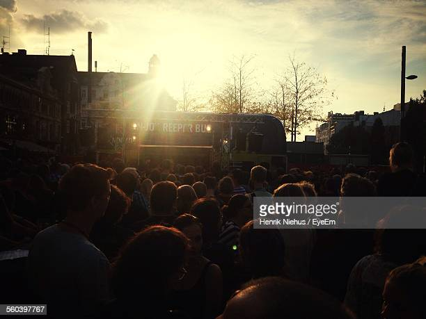 people in festival on reeperbahn street against sky - reeperbahn stock pictures, royalty-free photos & images