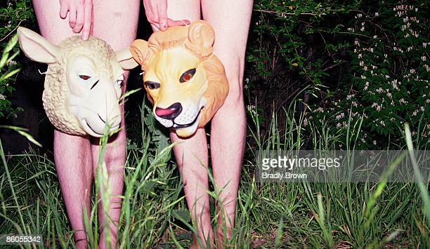 People in field with animal masks