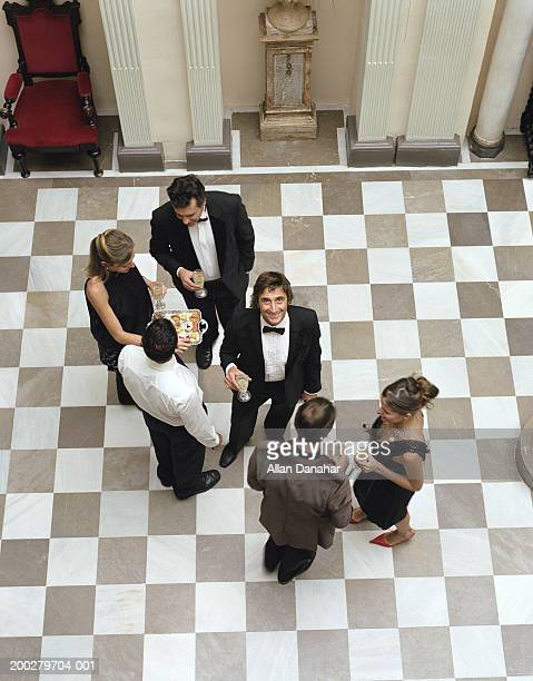 people in formal attire, holding champagne glasses, elevated view - formal stock pictures, royalty-free photos & images