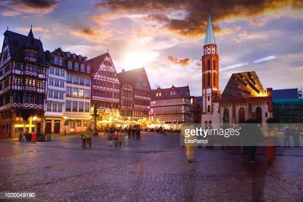 people in frankfurt old town square at dusk - pedestrian zone stock pictures, royalty-free photos & images