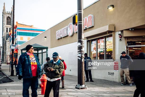 people in front family dollar store on germantown avenue, philadelphia - family dollar store stock pictures, royalty-free photos & images