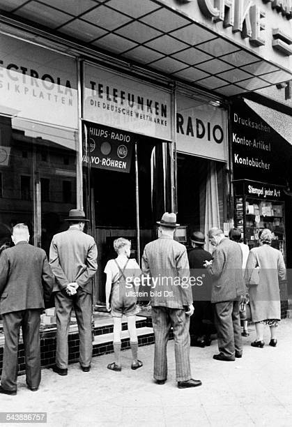 People in front of a radio shop Photographer Curt Ullmann Published by 'Hier Berlin' undatedVintage property of ullstein bild
