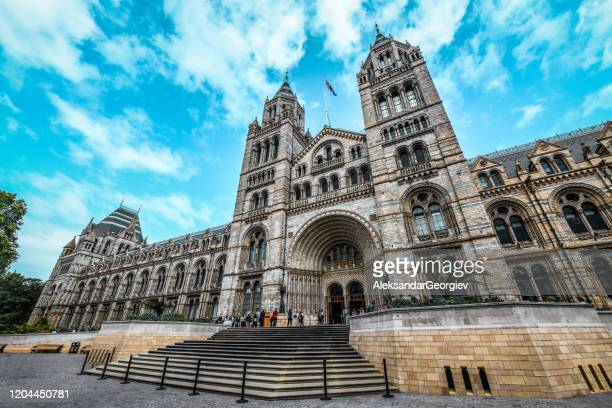 people in front of london national history museum - history museum stock pictures, royalty-free photos & images