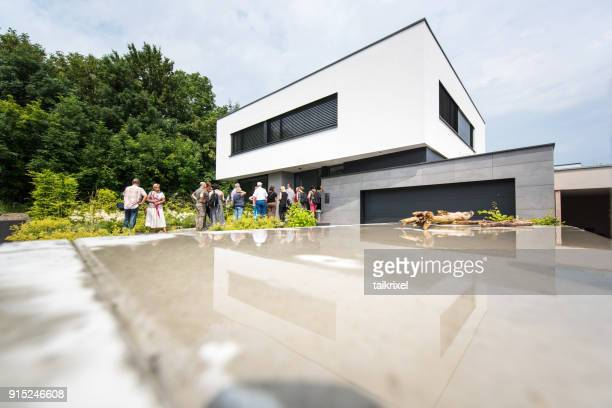 people in front of modern residential building, erfurt, germany, europe - prosperity stock pictures, royalty-free photos & images